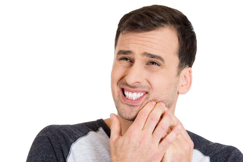 Боль во время отбеливания зубов и после